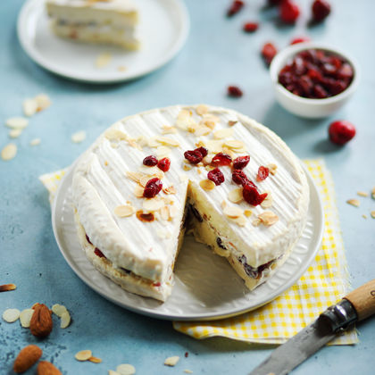 Brie stuffed with cranberries and almonds