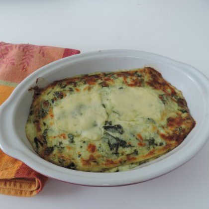 Gratin with spinach and potatoes with raclette cheese